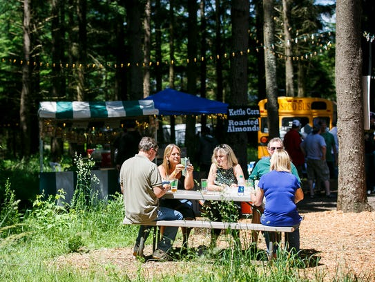 Oregon Garden Brewfest attendees check out beer lists