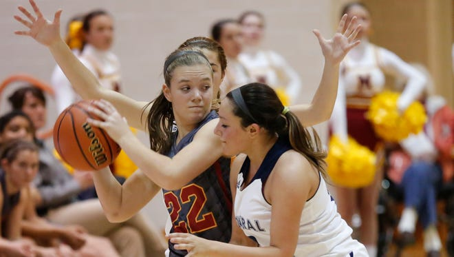 McCutcheon's Anabelle Knoy is wrapped up by Alyssa Tharp and Emma Gerrety (background) of Central Catholic in the J&C Hoops Classic Monday, November 16, 2015, at Harrison High School. CC beat McCutcheon 50-27.