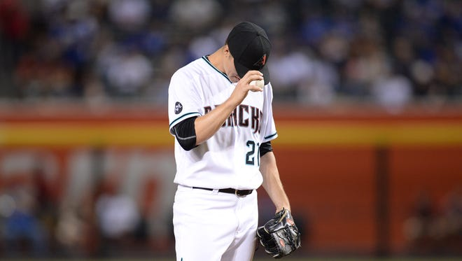 Sep 16, 2016: Arizona Diamondbacks starting pitcher Zack Greinke (21) reacts during the first inning against the Los Angeles Dodgers at Chase Field.