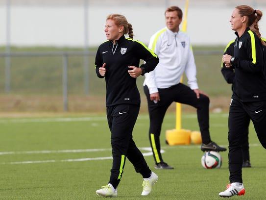 Defender Lori Chalupny (left) during training in preparation