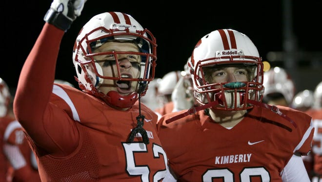 Kimberly High School's Josh Hulwi and David Lallier celebrate on the sidelines after a touchdown in Friday's semifinal game. The Papermakers are looking to win their third straight state championship on Friday.