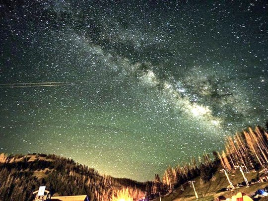 The night sky above campers at Ski Apache filled with stars and a trace of clouds.