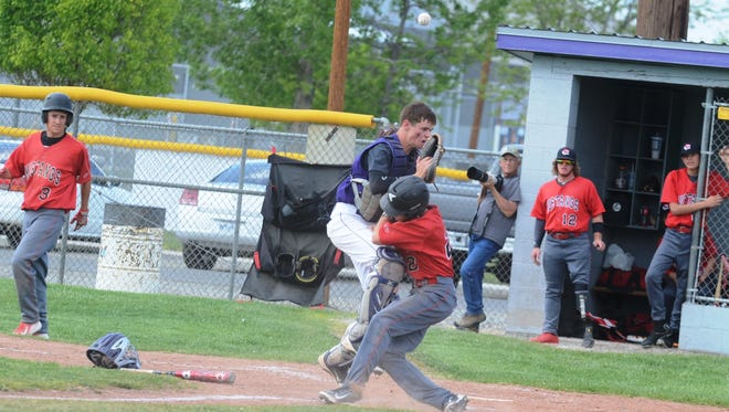 Yerington freshman catcher Michael Nicholas can't quite hang on to a late-arriving throw on a close play at the plate during last Saturday's nine-inning 12-11 win over visiting Lovelock, which hosts the league tournament this weekend.