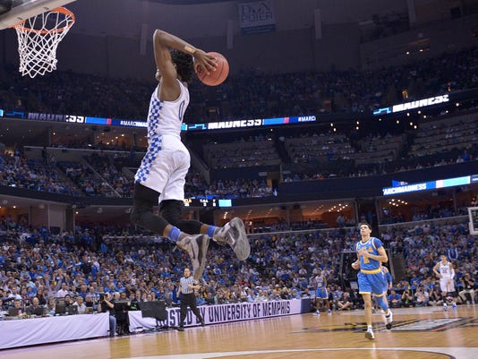 Kentucky guard De'Aaron Fox heads to the hoop against UCLA in the second half of an NCAA college basketball tournament South Regional semifinal game Friday, March 24, 2017, in Memphis, Tenn. (AP Photo/Brandon Dill)
