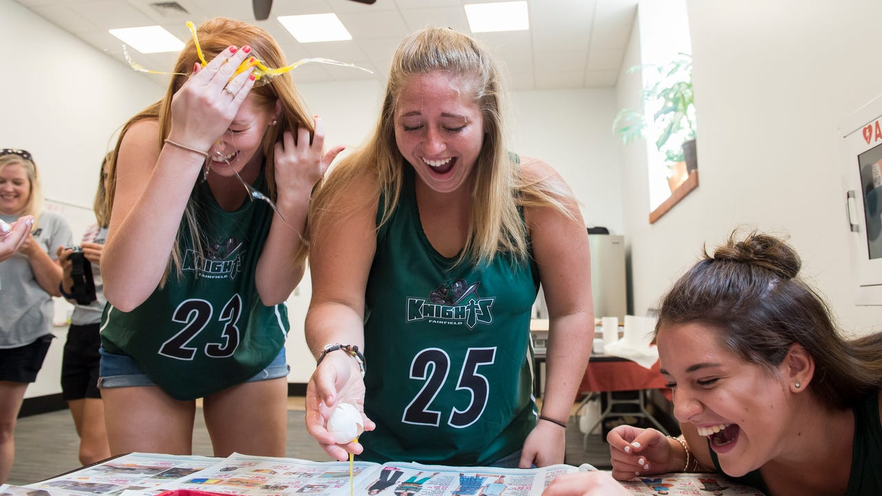 """The yolk's on these student athletes from Adams County and the Hanover area, who took part in the """"egg roulette"""" challenge at fall sports media day on August 2, 2017."""