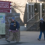 Students walk on the Camden campus of Rutgers University.