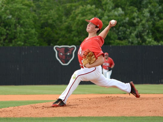 Junior Panther Nicholas Russel pitches against Gulfport Saturday during their playoff game in Petal.