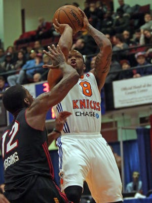 Westchester Knicks Ra'Shad James (8) goes up for two over Sioux Falls  DeAndre Liggins (12) in the playoffs at County Center in White Plains April 5, 2016.