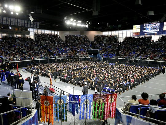 MTSU graduates walk the stage during the afternoon graduation at MTSU, on Saturday, Dec. 10, 2016.