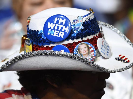 A delegate from Florida displays a hat supporting Hillary Clinton during the 2016 Democratic National Convention at Wells Fargo Arena in Philadelphia.