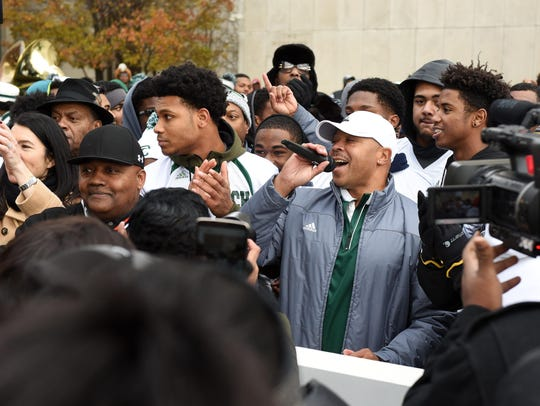 Thomas Wilcher addresses the crowd during a downtown