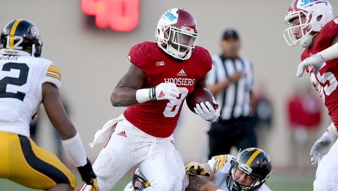 ndiana Hoosiers running back Jordan Howard (8) runs by the Iowa Hawkeyes defense for a touchdown in the first quarter of their game. The Indiana Hoosiers play the Iowa Hawkeyes Saturday, November 7, 2015, afternoon at Memorial Stadium in Bloomington, IN.
