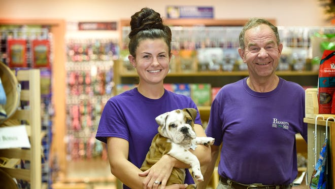 Katie Brandt-Weaver and her father, Robert Brandt pose on the showroom floor of Brandt's Mill on North Ninth Street, Lebanon. The business is celebrating its 75th anniversary.