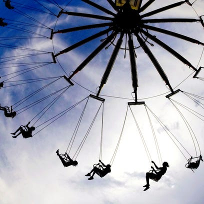 Fairgoers ride the swings at the 2014 Tennessee State