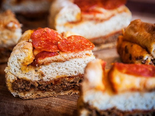 A deep dish, triple-layer pizza prepared by Andrea Keesling.