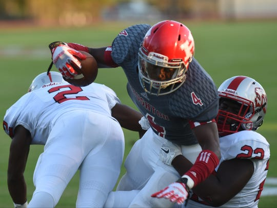 Haughton's Lavonta' Gipson lunges into the end zone for a touchdown past Plain Dealing's  Kendrick Carper (2) and Zamadre Oliver (22) in the first quarter of their game. t