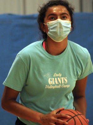 Kewanee High School's Ailynn Duarte practices basketball with a mask on July 13, 2020, at Good's Gym.