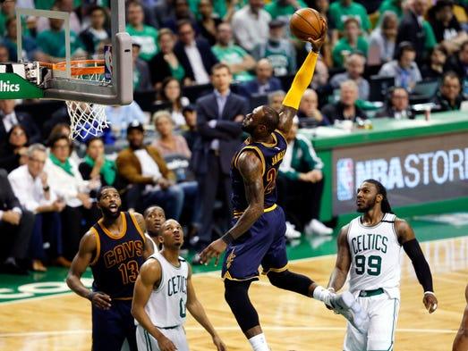 LeBron James dunks against the Boston Celtics during