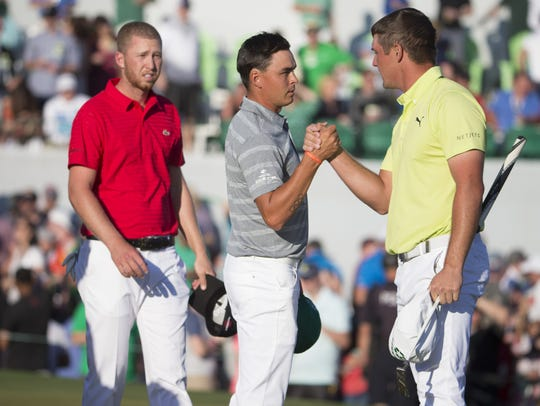 Daniel Berger (left), Rickie Fowler and Bryson DeChambeau finish the third round of the Phoenix Open on Saturday. Fowler sits in the lead going into the final round.