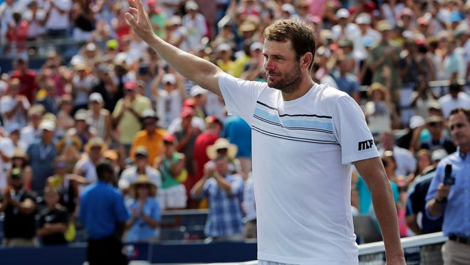 Mardy Fish waved to the crowd  after losing to Feliciano Lopez  of Spain during the second round of the U.S. Open tennis tournament in 2015. Fish returned to tennis that year after struggling with anxiety.