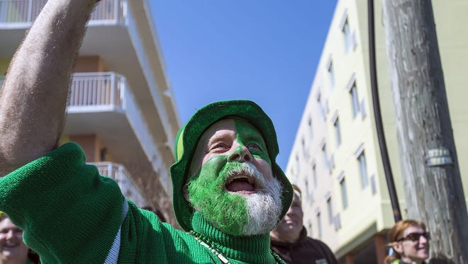 FILE IMAGE: Pennsylvania resident Tobin Lovelace begs for beads during the Ocean City St. Patrick's Day parade on 60th Street in 2014. This year's parade at the resort is March 12, 2016.