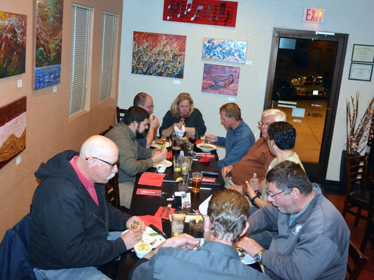 Folks gather on this Monday evening to enjoy a wide variety of items from the menu along with the newly added wine and beer menu.  Photo taken 12/12/16.