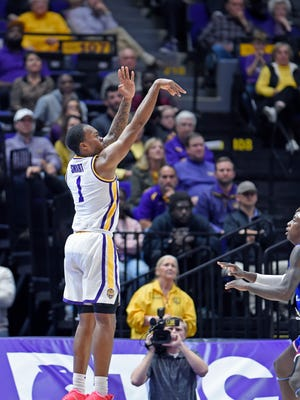 LSU guard Ja'vonte Smart (1) shoots for 3 of his 16 points in the game during the second half of an NCAA college basketball game against Louisiana Tech, Friday, Nov. 16, 2018, in Baton Rouge, La. LSU won 74-67. (AP Photo/Bill Feig)