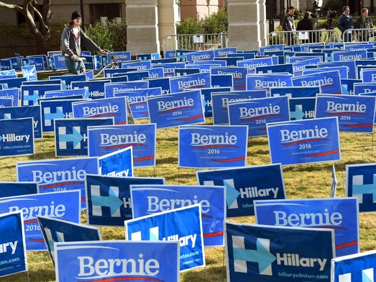 A group of signs for Bernie Sanders and Hillary Clinton