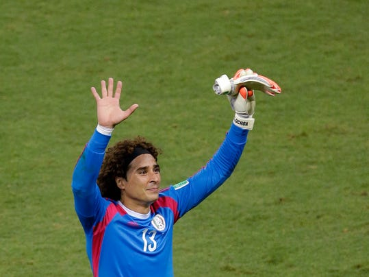 Mexico's goalkeeper Guillermo Ochoa waves to fans after the group A World Cup soccer match between Brazil and Mexico at the Arena Castelao in Fortaleza, Brazil, Tuesday, June 17, 2014.  (AP Photo/Themba Hadebe)