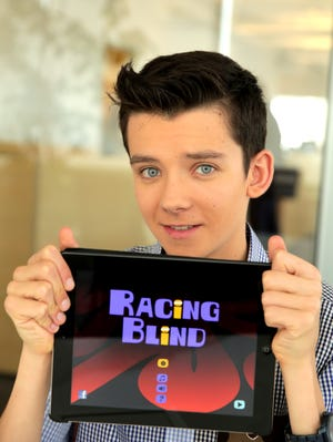 """Asa Butterfield shows """"Racing Blind,"""" the iPad app he created with his father."""