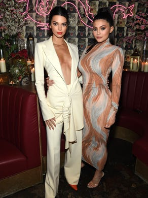 Jenner, seen here with her big sister Kendall on May 8, 2018, wore a form-fitting, high-neck dress with swirls of earth tones.