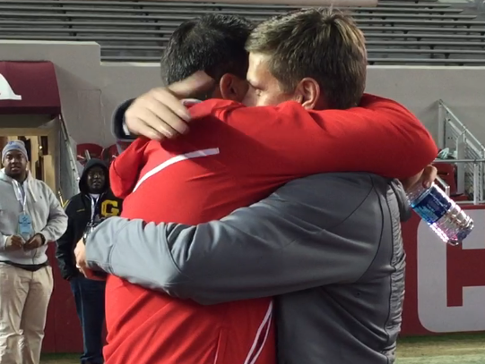Spanish Fort coach Ben Blackmon, left, and brother Brian Blackmon, who is Opelika's coach, hug after Spanish Fort won the Class 6A championship Friday at Bryant-Denny Stadium. They're both Robert E. Lee High graduates.