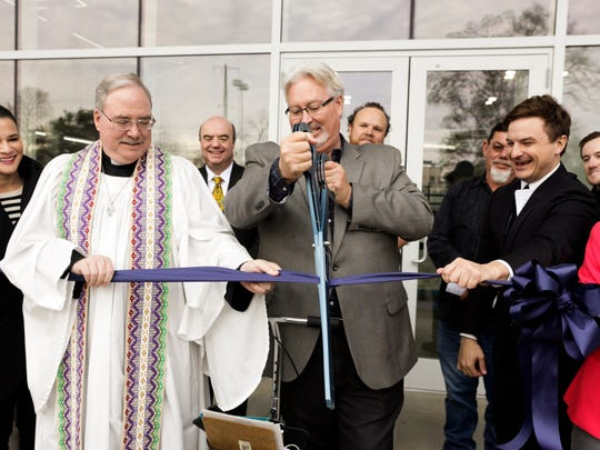 Headmaster Dr. Paul Baker, center, cuts the ribbon marking the grand opening of the new Enrichment Center at the Episcopal School of Acadiana Friday, Jan. 27, 2017.
