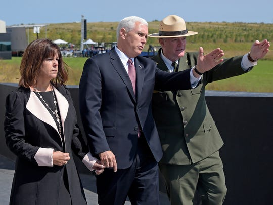 Stephen M. Clark, Superintendent of the Flight 93 Memorial, right, shows the flight path of United Flight 93 to Vice President Mike Pence and his wife Karen at the Flight 93 National Memorial in Shanksville, Pa., Monday, Sept. 11, 2017. (AP Photo/Fred Vuich)