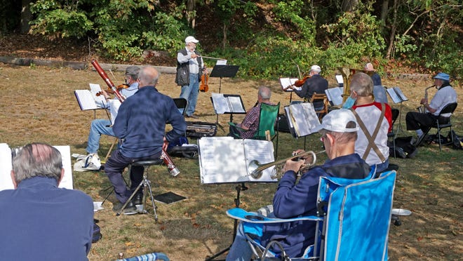 Howard Boksenbaum plays violin and leads the orchestra in a couple of numbers. The Providence Civic Orchestra of Senior Citizens rehearses Thursday mornings on the shore of the Seekonk River near the Narragansett Boat Club boathouse in Providence.