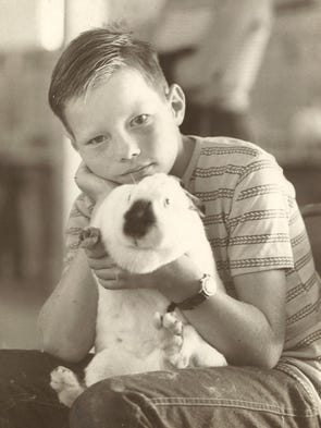 A boy holds on to his bunny at the Larimer County Fair in 1977.