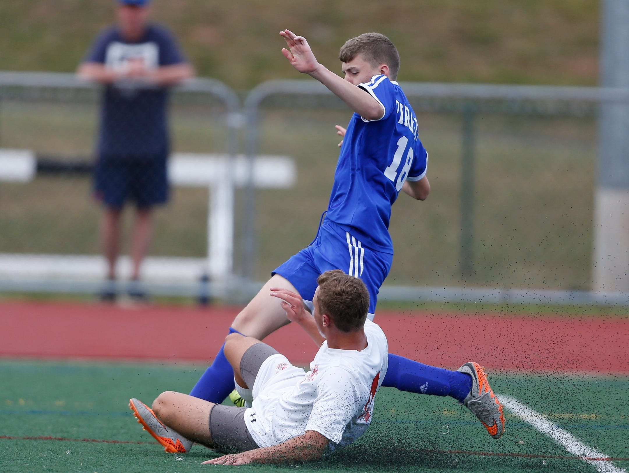 Tappan Zee's Joseph Stahl (4) puts a slide tackle on Pearl River's Owen O'Toole (18) during a boys soccer action at Tappan Zee High School in Orangeburg on Saturday, September 24, 2016.