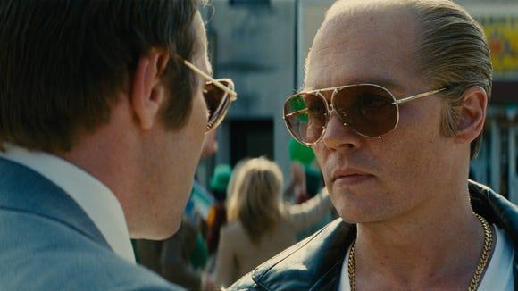 Boston mobster Whitey Bulger (Johnny Depp, right) is