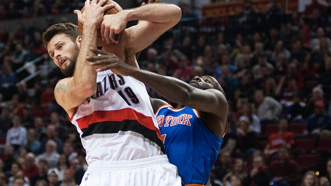 Portland Trail Blazers center/forward Joel Freeland (19) and Knicks forward Quincy Acy battle for control of the ball in the first quarter Sunday.