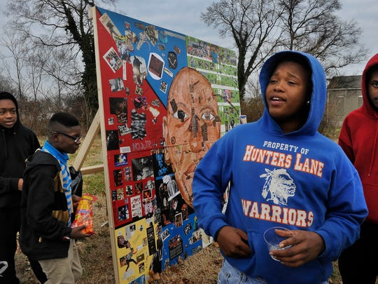 Student artists, from left, LeDarious Barlow, Damion Huff, Greg Patton and Antonio Jones were on hand Dec. 20 to display the mural they and others created at the Oasis Center to challenge stereotypes of young black men.