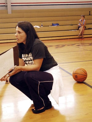 Andrea Brodhead, shown here at a 2005 practice during her long stint as the director of the Acadiana Stars AAU girls basketball program, died Thursday evening after a long bout with cancer. Brodhead is the wife of UL women's basketball coach Garry Brodhead.