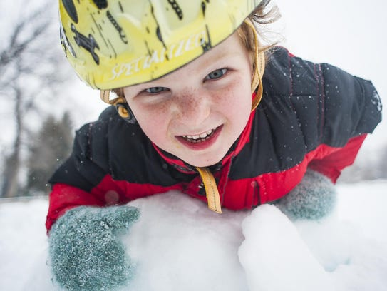 Finnegan Frisbie, 4, plays on a pile of ice instead