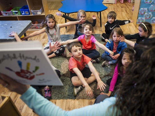 Deb Huestis reads Beautiful Hands to a class of preschoolers