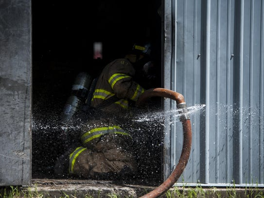 Firefighters practice rescues during a controlled burn