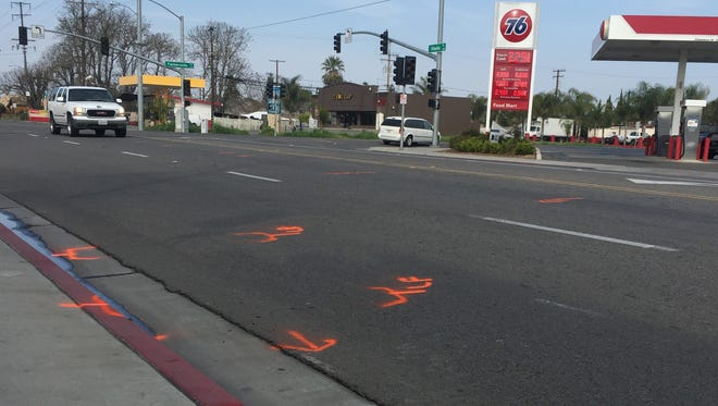 A Sport Utility Vehicle drive pass markings of fatal traffic collision in Farmersville Friday.