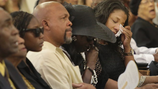Marilyn Ann Reagins, in black hat, the mother and Angela Reagins-Boyd the sister of Tierra LeeAnn Reagins, attend Tierra's memorial service on Saturday, September 6, 2014 at the First Baptist Church in Palm Springs.