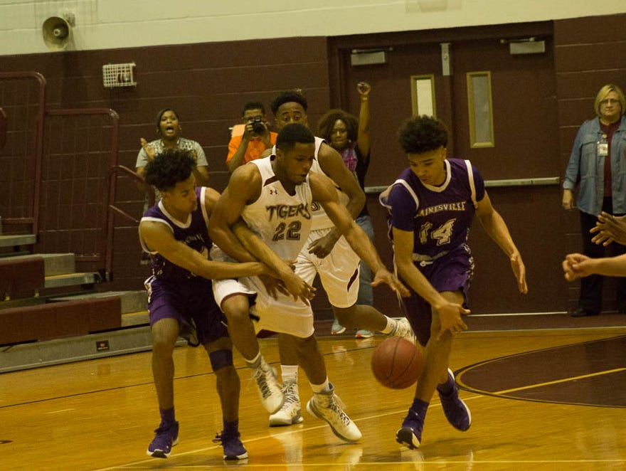 PHS' Devin Gadson scraps for a loose ball during the win over Gainesville in the Region 1-6A Finals. Pensacola High will prepare for and travel to Lakeland for the 6A state semis this week.