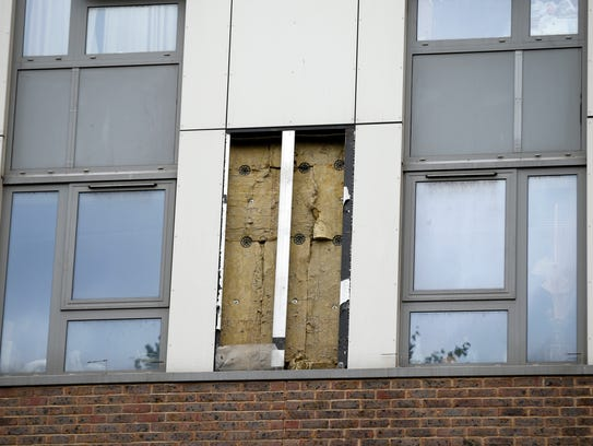 Part of the cladding is removed from a housing tower,