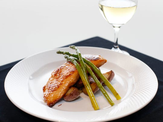 A pan-roasted, bourbon-glazed salmon is served with