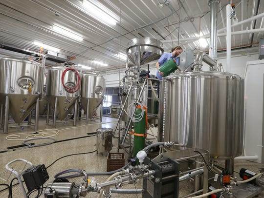 Brewmaster Colin Brumsted works on a batch of witbier